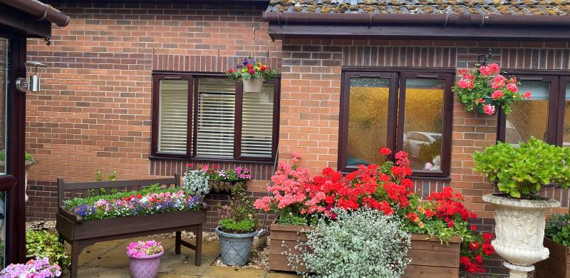 Flowers at the front entrance to home
