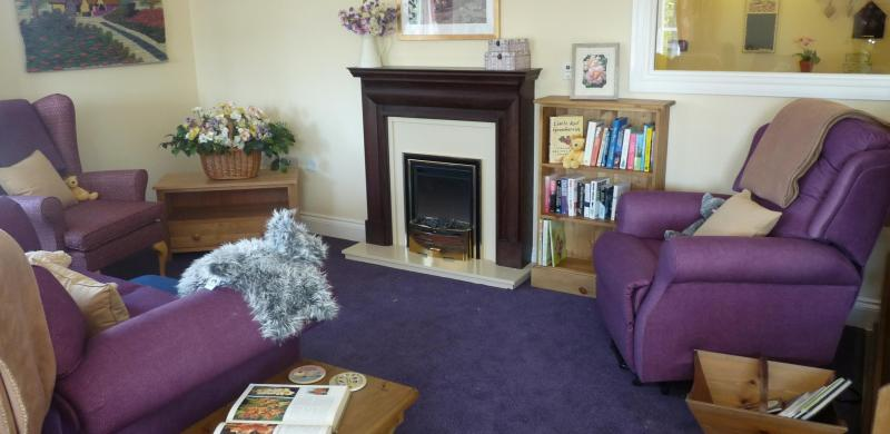 Large armchairs around a fireplace